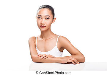 Attractive young adult Asian woman looking at camera....
