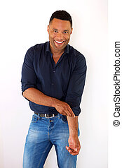 Attractive young african american man standing against white background