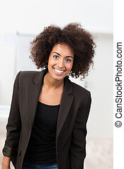 Attractive young African American student with a wild afro...