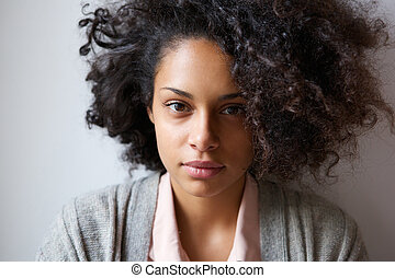 Attractive young african american woman looking at camera -...