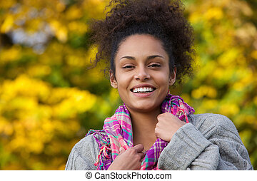Attractive young african american woman smiling in autumn
