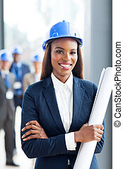 young african construction manager holding blue print