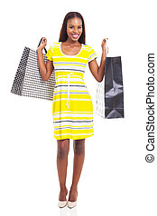 young african woman carrying two shopping bags