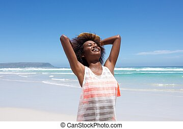 Attractive  young african woman enjoying a day at the beach