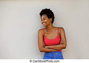 Attractive young african woman looking at copy space