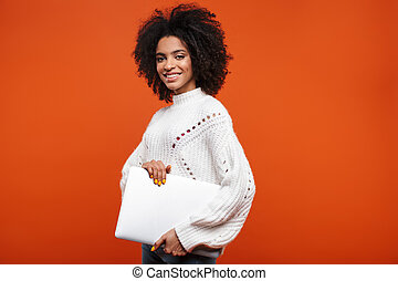 Attractive young african woman standing