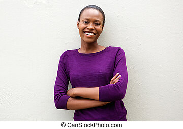 Attractive young african woman with arms crossed
