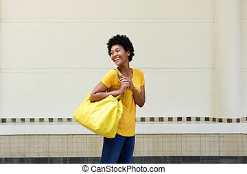 Attractive young african woman with handbag