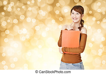 Attractive young Asian woman hold document