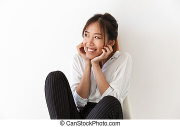 Attractive young asian woman sitting on a chair