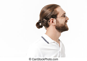 Attractive young bearded man wearing casual outfit standing