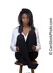 Attractive Young Black Woman Sitting On Stool