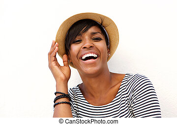 Attractive young black woman smiling with hat