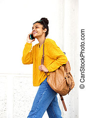 Attractive young black woman talking on mobile phone