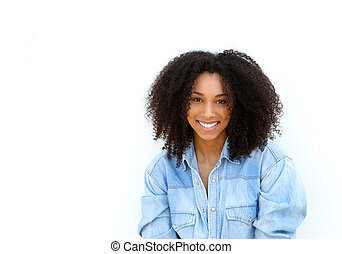 Attractive young black woman with curly hair smiling