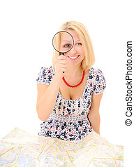 Attractive young blonde holding magnifying glass