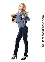 Attractive young blonde posing with two dogs