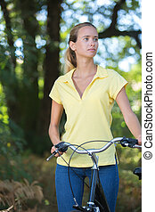 attractive young blonde woman on a bike