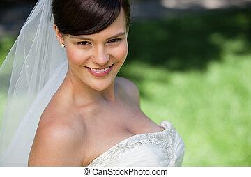 Attractive young bride smiling