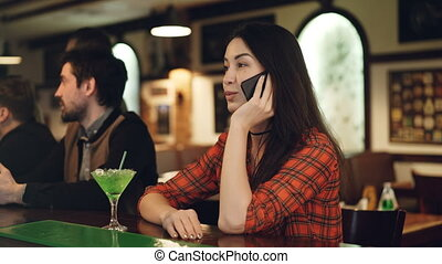 Attractive young brunette is calling her boyfriend while...