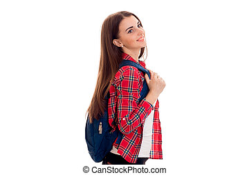 Attractive young brunette student girl with blue backpack isolated on white background