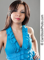 young brunette woman in a blue dress