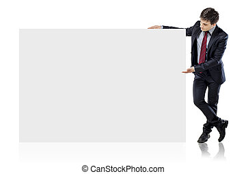 attractive young business man and blank board on white background