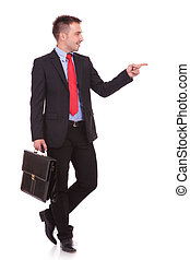 Attractive young business man pointing at something