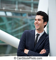 Attractive young businessman smiling outdoors