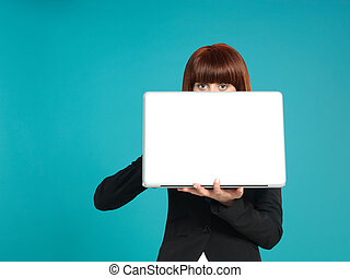 attractive, young businesswoman, eyes showing behind laptop