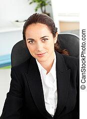 Attractive young businesswoman sitt
