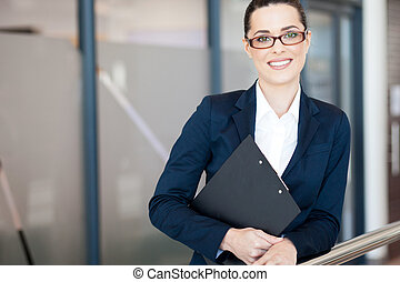 attractive young businesswoman portrait in office