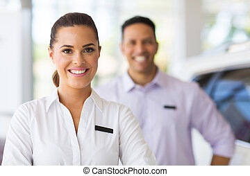 young car saleswoman in showroom