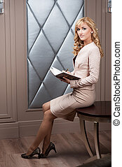 business woman sitting with open book