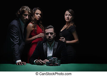 Attractive young caucasian man make bet in the casino