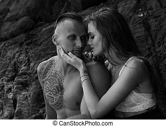 Attractive young couple by the rocks