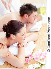 Attractive young couple enjoying a back massage