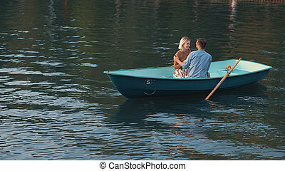Attractive young couple in a boat