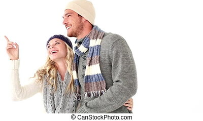 Attractive young couple in winter clothes on white...
