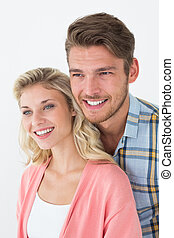 Attractive young couple looking away