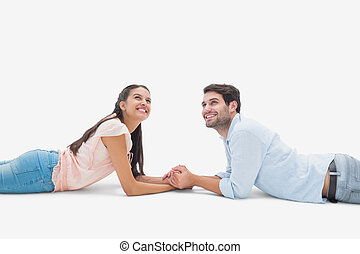 Attractive young couple looking up