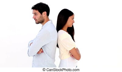 Attractive young couple not talking on white background