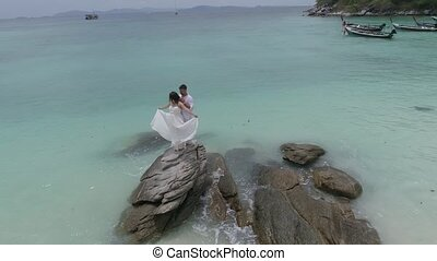 Attractive young couple on the tropical island - Aerial view...