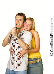 Attractive young couple singing karaoke isolated on white background