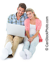 Attractive young couple sitting
