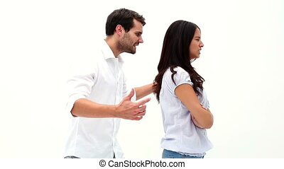 Attractive young couple having a fight on white background