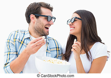 Attractive young couple watching a 3d movie