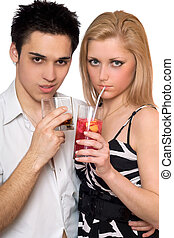 Attractive young couple with cocktails. Isolated