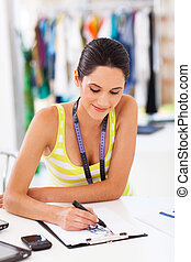 young fashion designer drawing - attractive young fashion ...