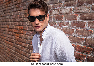 Attractive young fashion man looking at the camera